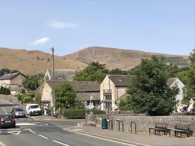 village of Castleton nestled below Mam Tor