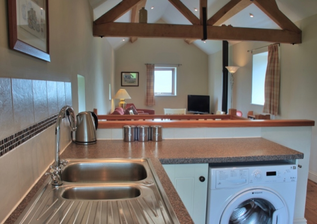 Byre holiday cottage kitchen and living area