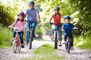 family cycling along a trail