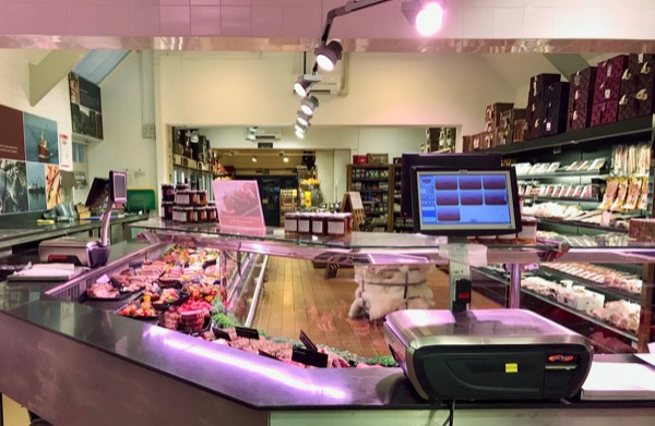 Behind the meat counter