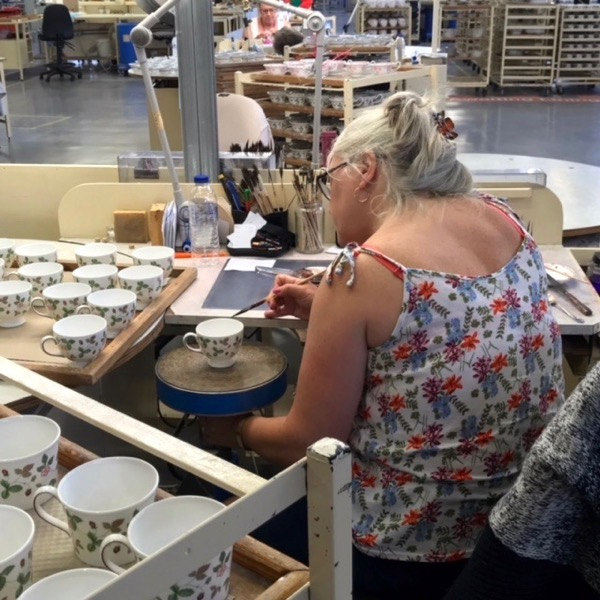 Adding the gold lines on the Wedgwood factory tour